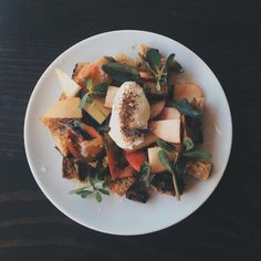 White peach and heirloom tomato panzanella with burrata za'atar, basil, and sherry