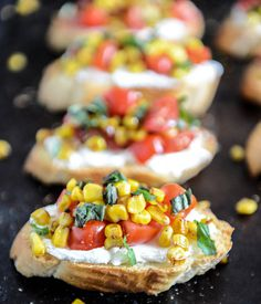 summer crostini with whipped roasted garlic goat cheese. #cheese #whipped #goat #crostini #garlic #summer #roasted #with