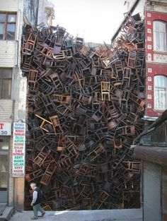1550 Chairs Stacked Between Buildings - My Modern Metropolis #art #installation