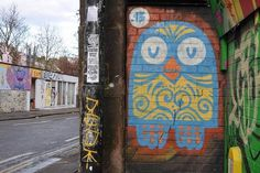 45RPM | Owl design on wall | Facade street art from Stokes Croft #mural #painting