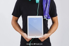 Man in summer wear showing tablet Free Psd. See more inspiration related to Mockup, Technology, Summer, Template, Man, Mock up, Tablet, App, Screen, Device, Up, Towel, Guy, Holding, Wear, Mock and Showing on Freepik.