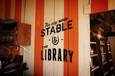 Library, wall sign, interior Urban Influence