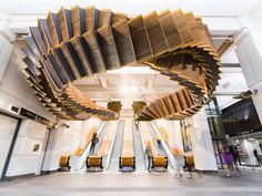 80-Year-Old Wooden Escalators are Repurposed as a Sculptural Ribbon by Artist Chris Fox | Colossal