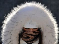 Cold snap paralyzes Europe Photos | Cold snap paralyzes Europe Pictures - Yahoo! News #fur #hat #white #winter