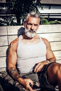 Buff, bearded, and tattooed.