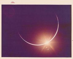 NASA\'s Golden Age —Earth eclipsing the sun, seen from Apollo 12, November 1969