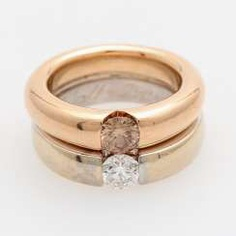 Ladies ring made of 2 solitaire rings with 2 diamonds