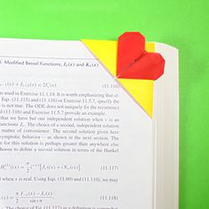 How to make a top-corner heart origami bookmark (http://www.origami-make.org/howto-origami-bookmark.php)