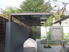 160415_2-A-pergola-with-glass-panelled-roof-covers-the-outdoor-kitchen-in-Camberwell-garden-designed-and-constructed-by-Melbourne-garden-design-company-Ian-Barker-Gardens.jpg (800×600)