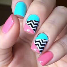 Try out baby colors for your winter nail art. Check out this amazing combination of baby pink, baby blue, black and white colors with zigzag