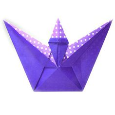 How to make a spell-casting origami wizard (http://www.origami-make.org/howto-origami-halloween.php)