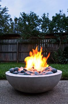 DIY Concrete fire bowl with river rocks