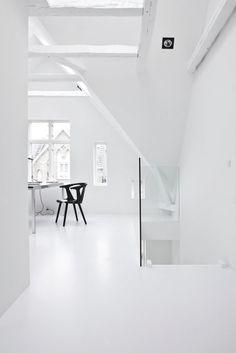 White attic workspace. Copenhagen Townhouse II by Norm Architects. © Jonas Bjerre-Poulsen. #attic #workspace