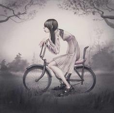 Niña en bicileta de annie owens