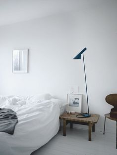 White Bedroom with AJ Floor lamp and Ant chair. #bedroom