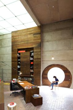 Archohm Studio in New Delhi, India by Archohm #interior #girl #office #bookcase #desk