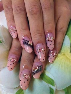 Rock your nails in these glamorous pink nail ensembles! A very playful design that combines dots, flowers and lace-like designs into one, lo