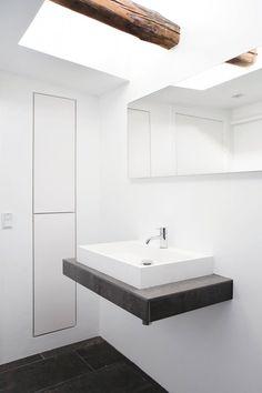 Bathroom vanity under skylight. Fredgaard Penthouse by Norm.Architects. © Jonas Bjerre-Poulsen. #bathroom #beam #skylight