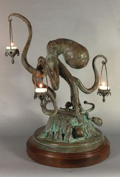 """Walktopus."" Bronze statue. by Scott Musgrove. A walking octopus candle holder sculpture. In real life. #candle #sculpture #octopus #copper"