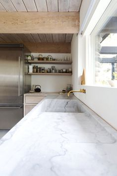 North Vancouver House by Scott & Scott Architects. #scottandscottarchitects #kitchen #marble #sink #minimal