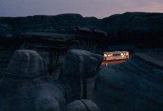 A mobile home shines amid eerie rock formations in Alberta, Canada, October 1970.Photograph by W.E. Garrett, National Geographic