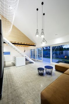 """""""Under the Calvary"""" House Has Traditional Shape and Modern Interiors"""