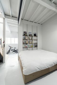 Partitioned sleeping area. Re:Toyosaki by coil _ k.m architects. © Yoshiro Masuda. #bedroom #industrial #guestroom
