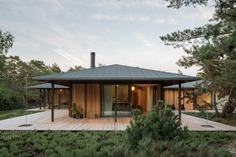 Exterior, Wood Siding Material, House Building Type, Metal Roof Material, and Hipped RoofLine Photo 1 of 13 in An Idyllic Swedish Summer House Channels Japanese Vibes from Summerhouse T