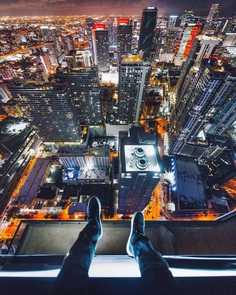 Daredevil Photographer Denis Krasnov Climbes Huge Skyscrapers To Take Stunning Photos