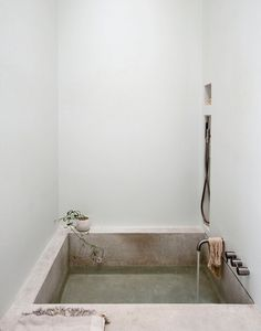 Concrete bathtub in an alcove. Bathroom collection. Photo by Matthew Williams. #bathroom #concrete #alcove #shower
