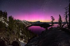 Purple Haze sky over the slopes of the rim of Oregon\'s Crater Lake National Park photographed by Brad Goldpaint
