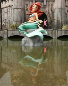 Banksy, Dismaland, sculpture, installation, Disney, water, mermaid, glitch, technology, satire
