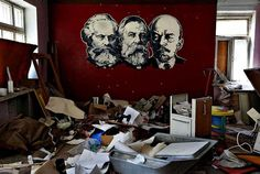 The portraits of Marx, Engels, and Lenin are seen on the wall of a shelled rehabilitation center for alcohol and drug addicts in Sloviansk