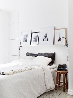 floating shelf with art // white with hints of grey&black #white #design #interiors #bedroom #love