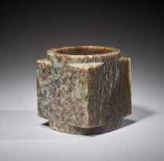 A SUPERB CUBE-SHAPED CONG WITH FINELY POLISHED SIDES CARVED FROM MOTTLED BROWN JADE
