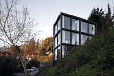 The Arco House: where economy dictates concise design - Architecture - Domus #house #hill #design #modest #black #architecture