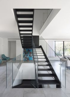 L-Shaped Home Organized Around a Central Steel Staircase 5