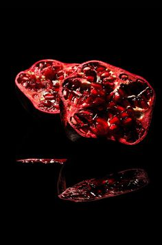Juicy Pomegranate by Niermala B. Timmers www.niermalatimmers.com #timmers #red #pomegranate #fruit #black #mirror #photography #niermala #bouwina #still #life