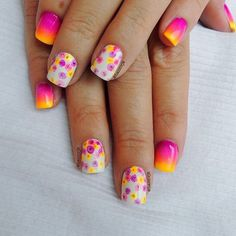 Take a look at this cute flower themed gradient nail art design.