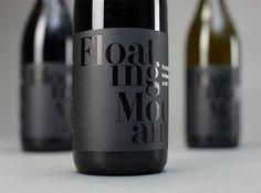 Wine Label: black foil onto black printed paper.