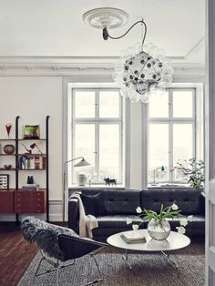 A Stunning Stockholm Apartment Photo #stockholm #apartment #lamp #chair #couch