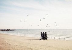 Three man in black | Flickr - Photo Sharing! #coney #jews #city #island #york #beach #new