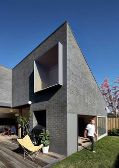 This Black Brick House Features Generous Spaces with a High Degree of Flexibility