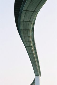 tracer bullets scratched scarlet lines across the sky. - decapitate animals #winding #bridge #road #photogrpahy