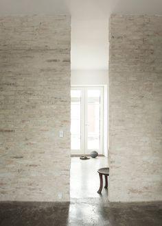 Rustic #brickwalls and #concretefloor. #HumlebaekHouse by #NormArchitects. Photo by #JonasBjerrePoulsen.