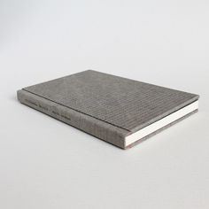 Designer binding by Kaija Rantakari, 2017. A variation of the sewn boards binding with typewritten binary code linen covers and pink leather