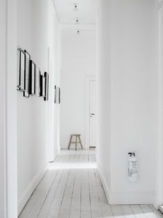 White hallway. Lotta Agaton home in Stockholm. Photo by Pia Ulin. #hallway #minimal
