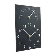 The Thermometer & Time Clock is a smart two-in-one clock that lets you monitor the temperature and keep track of time. Designed to be wall-mounted and readable from a distance, it features a minimalist clock face against a slate-like body made from recycled paper. A functional and decorative addition to any indoor space.