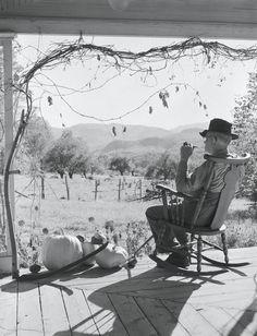 A farmer enjoys autumn on his land in the 1950s.