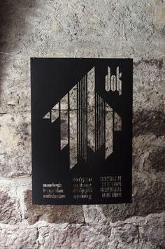 Dok is a stencil font made out of nine pieces. All letters are built various combinations of those shapes. Dok comes in a regular and a bold #font #black #stencil #poster #typography